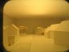 Des fenêtres pratiquées dans le plan permettent d'observer des maquettes d'études, ici celle d'implantation du projet LION